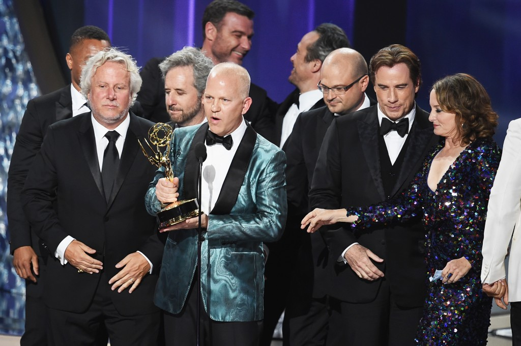 LOS ANGELES, CA - SEPTEMBER 18:  (L-R) Writers Larry Karaszewski and Scott Alexander, writer/producer Ryan Murphy, actor John Travolta and production team accept Outstanding Limited Series for 'The People v. O.J. Simpson: American Crime Story' onstage during the 68th Annual Primetime Emmy Awards at Microsoft Theater on September 18, 2016 in Los Angeles, California.  (Photo by Kevin Winter/Getty Images)
